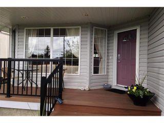 Photo 2: 148 GLENEAGLES Close: Cochrane House for sale : MLS®# C4010996