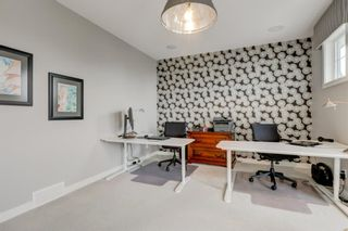 Photo 22: 707 Shawnee Drive SW in Calgary: Shawnee Slopes Detached for sale : MLS®# A1109379