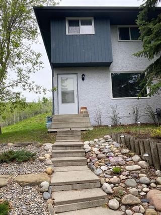 Photo 1: 12 800 bow croft Place: Cochrane Row/Townhouse for sale : MLS®# A1117250