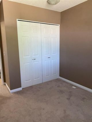 Photo 12: 554 STRATHCONA Drive SW in Calgary: Strathcona Park Semi Detached for sale : MLS®# A1020759