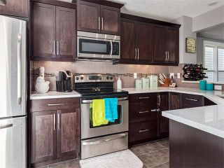 Photo 4: 18 WINDWOOD Grove SW: Airdrie House for sale : MLS®# C4082940