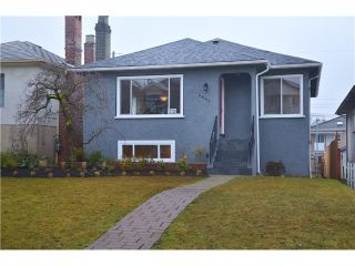 Photo 1: 4847 HENRY Street in Vancouver: Knight House for sale (Vancouver East)  : MLS®# V996847