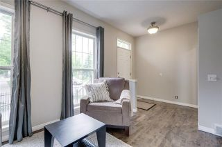 Photo 2: 130 INVERNESS Square SE in Calgary: McKenzie Towne Row/Townhouse for sale : MLS®# C4302291