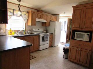 """Photo 8: 10051 100A Street: Taylor Manufactured Home for sale in """"TAYLOR"""" (Fort St. John (Zone 60))  : MLS®# N229161"""