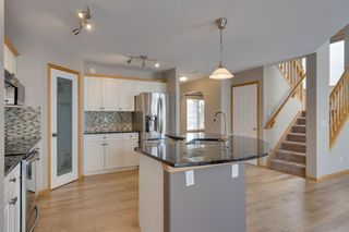 Photo 3: 106 Arbour Butte Road NW in Calgary: Arbour Lake Detached for sale : MLS®# A1075299