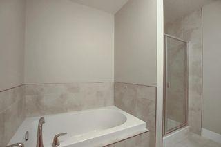 Photo 18: 374 Quarry Park Boulevard SE in Calgary: Douglasdale/Glen Row/Townhouse for sale : MLS®# A1063797