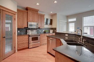 Photo 9: 212 Somme Avenue SW in Calgary: Garrison Woods Row/Townhouse for sale : MLS®# A1129738
