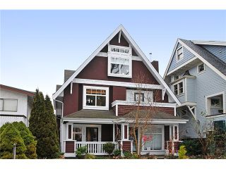"""Photo 1: 1865 E 7TH Avenue in Vancouver: Grandview VE 1/2 Duplex for sale in """"""""THE DRIVE"""""""" (Vancouver East)  : MLS®# V863836"""