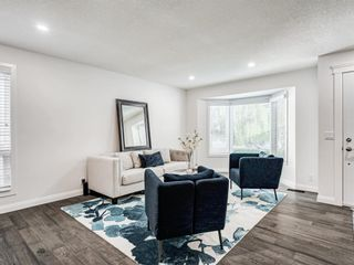 Photo 5: 171 Woodstock Place SW in Calgary: Woodlands Detached for sale : MLS®# A1047853
