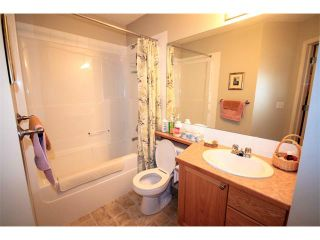 Photo 11: 2 117 BOW RIDGE Drive: Cochrane House for sale : MLS®# C4003118