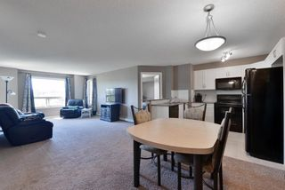 Photo 5: 2408 60 PANATELLA Street NW in Calgary: Panorama Hills Apartment for sale : MLS®# A1114606