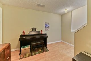 Photo 28: 128 Inverness Square SE in Calgary: McKenzie Towne Row/Townhouse for sale : MLS®# A1119902