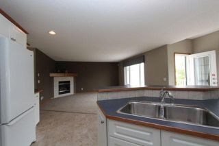 Photo 6: 180 FAIRWAYS Drive NW: Airdrie Residential Detached Single Family for sale : MLS®# C3526868