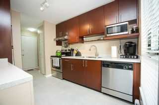 """Photo 2: 303 9155 SATURNA Drive in Burnaby: Simon Fraser Hills Condo for sale in """"Mountainwood"""" (Burnaby North)  : MLS®# R2042603"""