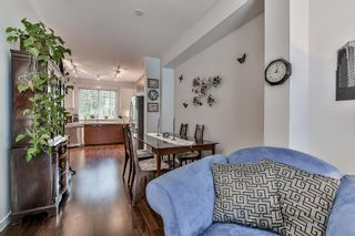 """Photo 6: 105 3010 RIVERBEND Drive in Coquitlam: Coquitlam East Townhouse for sale in """"WESTWOOD"""" : MLS®# R2109754"""