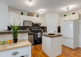 Photo 8: 76 Bridleridge Gardens SW in Calgary: Bridlewood Detached for sale : MLS®# A1134519