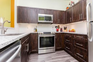 """Photo 4: 108 2340 HAWTHORNE Avenue in Port Coquitlam: Central Pt Coquitlam Condo for sale in """"BARRINGTON PLACE"""" : MLS®# R2177067"""
