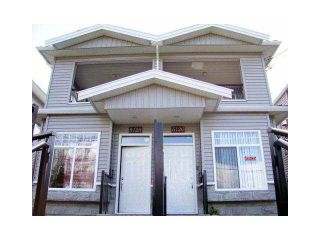 Photo 1: 5128 MANOR ST - LISTED BY SUTTON CENTRE REALTY in Burnaby: Central BN 1/2 Duplex for sale (Burnaby North)  : MLS®# V1100182