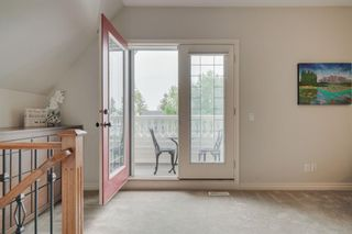 Photo 16: 212 Somme Avenue SW in Calgary: Garrison Woods Row/Townhouse for sale : MLS®# A1129738