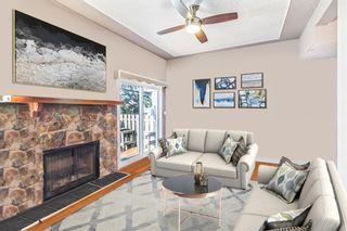 Photo 9: 155 Woodglen Grove SW in Calgary: Woodbine Row/Townhouse for sale : MLS®# A1111789