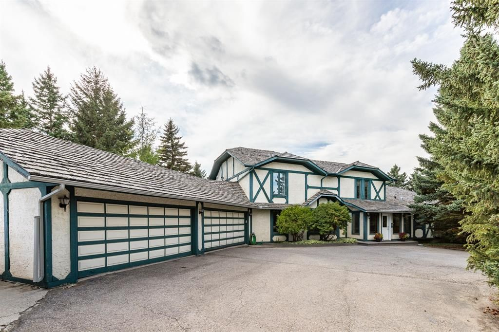 Main Photo: 255123 Woodland Road in Rural Rocky View County: Rural Rocky View MD Detached for sale : MLS®# A1142755
