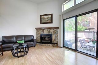 Photo 13: 24 GLAMIS Gardens SW in Calgary: Glamorgan Row/Townhouse for sale : MLS®# A1077235