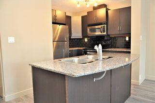 Photo 2: 2101 5605 HENWOOD Street SW in Calgary: Garrison Green Apartment for sale : MLS®# C4204085