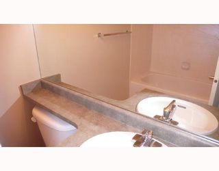 """Photo 5: 305 3520 CROWLEY Drive in Vancouver: Collingwood VE Condo for sale in """"MILLENIO"""" (Vancouver East)  : MLS®# V670239"""