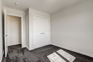 Photo 30: 136 Creekside Drive SW in Calgary: C-168 Semi Detached for sale : MLS®# A1108851