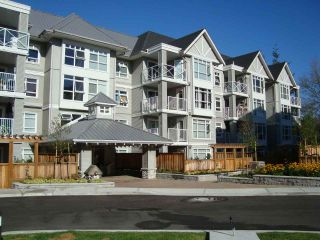 """Photo 1: 412 3136 ST JOHNS Street in Port Moody: Port Moody Centre Condo for sale in """"SONRISA"""" : MLS®# R2101760"""