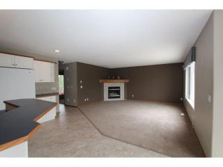 Photo 4: 180 FAIRWAYS Drive NW: Airdrie Residential Detached Single Family for sale : MLS®# C3526868