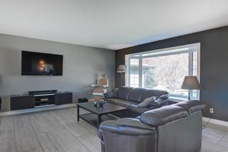 Photo 9: 204 MAPLE COURT Crescent SE in Calgary: Maple Ridge Detached for sale : MLS®# A1152517