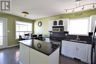 Photo 2: 224 14 Street E in Brooks: House for sale : MLS®# A1128343