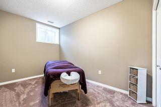 Photo 28: 494 Boulder Creek Way SE: Langdon Semi Detached for sale : MLS®# A1148702