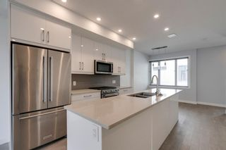 Photo 9: 104 1616 24th Ave NW in Calgary: Capitol Hill Row/Townhouse for sale : MLS®# A1104099