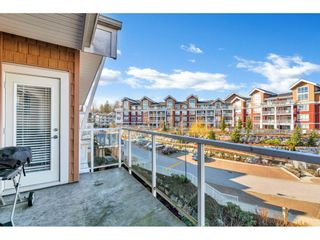 "Photo 2: 408 6440 194 Street in Surrey: Clayton Condo for sale in ""WATERSTONE"" (Cloverdale)  : MLS®# R2441400"