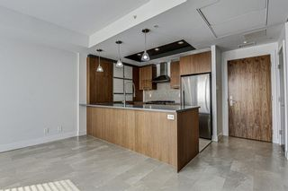 Photo 7: 14609 SHAWNEE Gate SW in Calgary: Shawnee Slopes Row/Townhouse for sale : MLS®# A1010386
