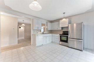 Photo 6: 8828 34 Avenue NW in Calgary: Bowness Detached for sale : MLS®# A1075550