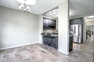 Photo 8: 115 Everhollow Street SW in Calgary: Evergreen Detached for sale : MLS®# A1145858