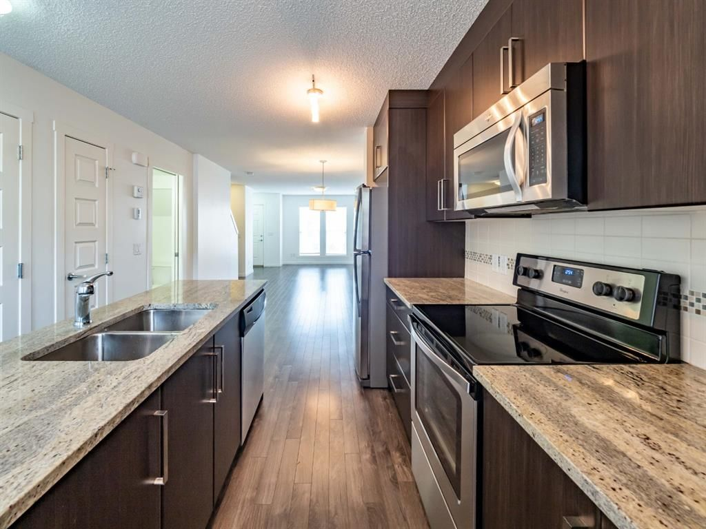 Photo 9: Photos: 544 Mckenzie Towne Close SE in Calgary: McKenzie Towne Row/Townhouse for sale : MLS®# A1128660