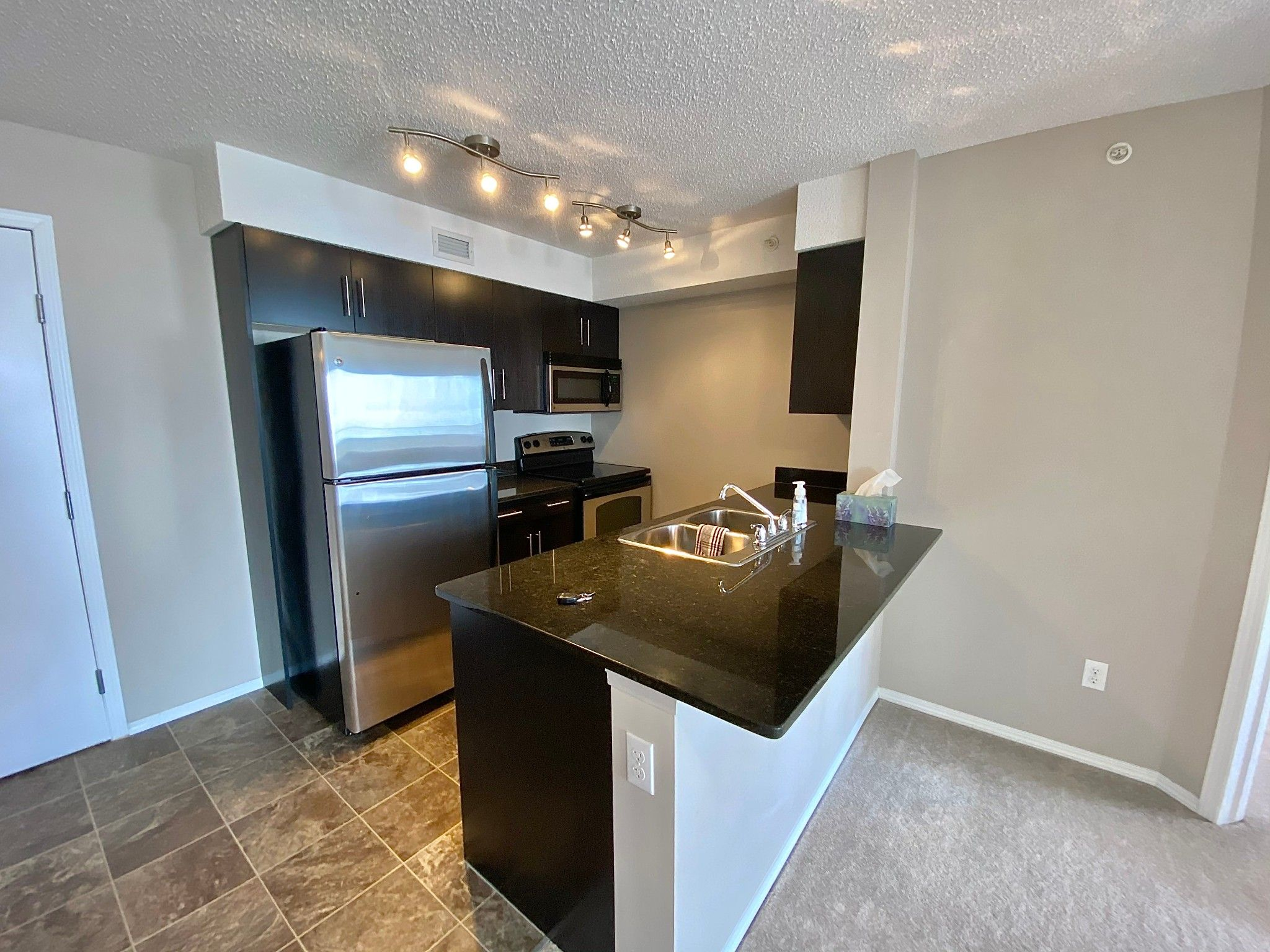 Main Photo: 11812 22 Ave in Edmonton: Condo for rent