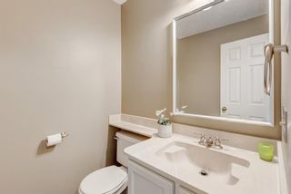 Photo 8: 21 12625 24 Street SW in Calgary: Woodbine Row/Townhouse for sale : MLS®# A1011993