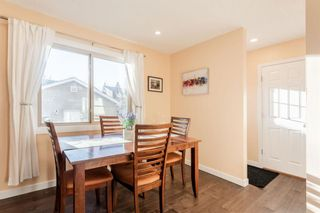 Photo 6: 1441 Ranchlands Road NW in Calgary: Ranchlands Row/Townhouse for sale : MLS®# A1061548