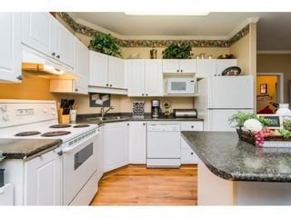 """Photo 8: 106 33502 GEORGE FERGUSON Way in Abbotsford: Central Abbotsford Condo for sale in """"Carina Court"""" : MLS®# R2262879"""