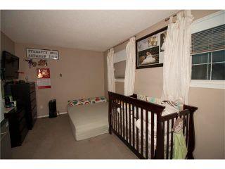 Photo 13: 1001 111 TARAWOOD Lane NE in Calgary: Taradale House for sale : MLS®# C4059766