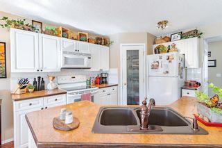 Photo 31: 21 Bow Ridge Crescent: Cochrane Detached for sale : MLS®# A1079980