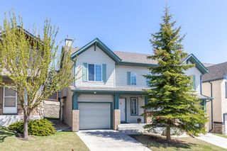 Photo 2: 85 Hidden Creek Rise NW in Calgary: Hidden Valley Row/Townhouse for sale : MLS®# A1104213