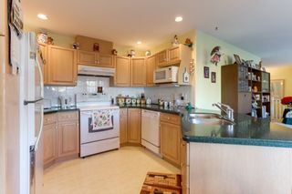 """Photo 11: 251 13888 70 Avenue in Surrey: East Newton Townhouse for sale in """"Chelsea Gardens"""" : MLS®# R2520708"""