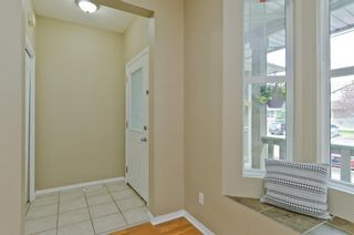 Photo 2: 205 2006 LUXSTONE Boulevard SW: Airdrie Row/Townhouse for sale : MLS®# A1010440