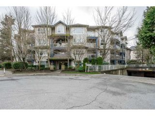 "Photo 1: 107 8115 121A Street in Surrey: Queen Mary Park Surrey Condo for sale in ""THE CROSSING"" : MLS®# R2553840"